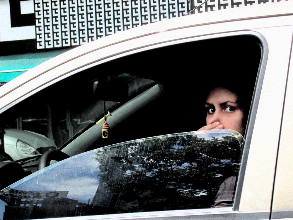 Woman in car website