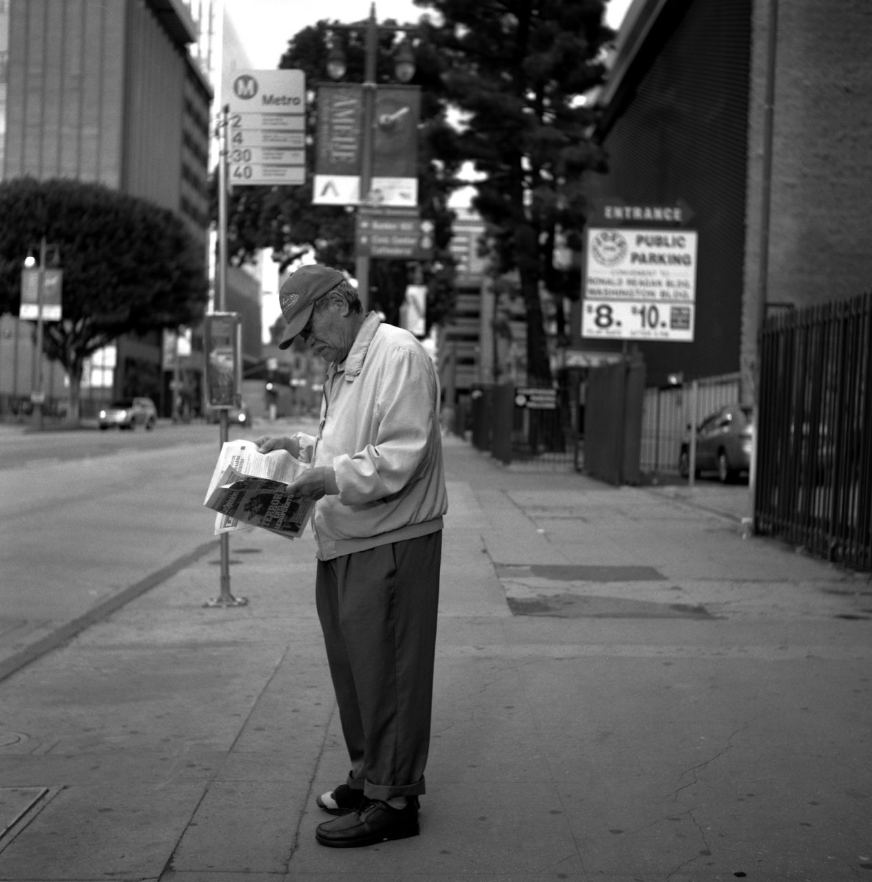 Mexican Man Reading Paper